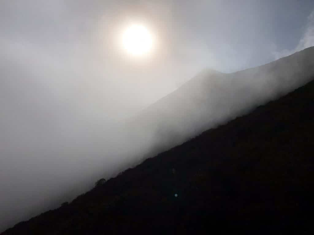 A fog-covered landscape, with the sun beyond.
